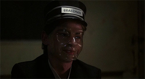 """Oh, you mean this mask? Just part of a brakeman's uniform, honey."""