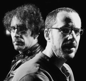 NEW YORK - MAY 10: Screenwriter and director Joel Coen (L) and his brother, filmaker, Ethan Coen (R) pose in their Manhattan office on May 10, 2004 in New York City.  The Coen brothers have made many successful films including Blood Simple, Raising Arizona, Barton Fink, Fargo, The Big Lebowski, and O'Brother Where Art Thou. (Photo by Jean-Christian Bourcart/Getty Images)