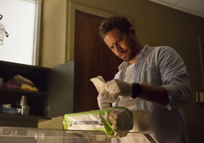 Paul Walker learns how to change a diaper.